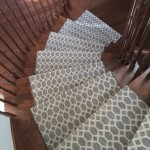 Modern geometric carpet runner for stairs and Hallways installed on curve staircase in East York