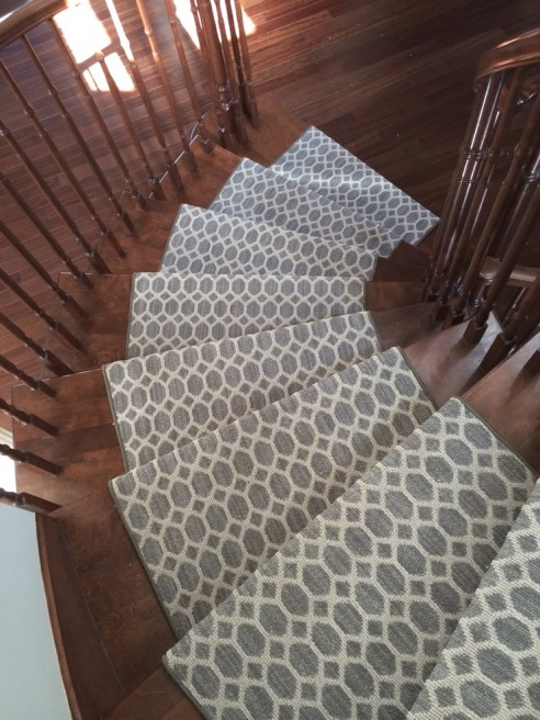 Tracy modern geometric carpet runner for stairs and Hallways installed on curve staircase