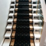 Black oriental carpet runner on stairs in Etobicoke, Open stair risers, staircase carpeting