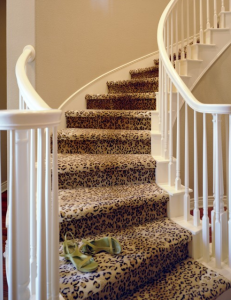animal print carpet runner for stairs and hallways installed on curve staircase in Etobicoke