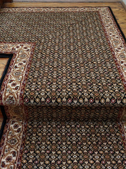 Mahi design persian carpet runners on stairs and landing area dark brown black