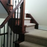 Stair Runner on dark staircase covering landing and stairs in King City