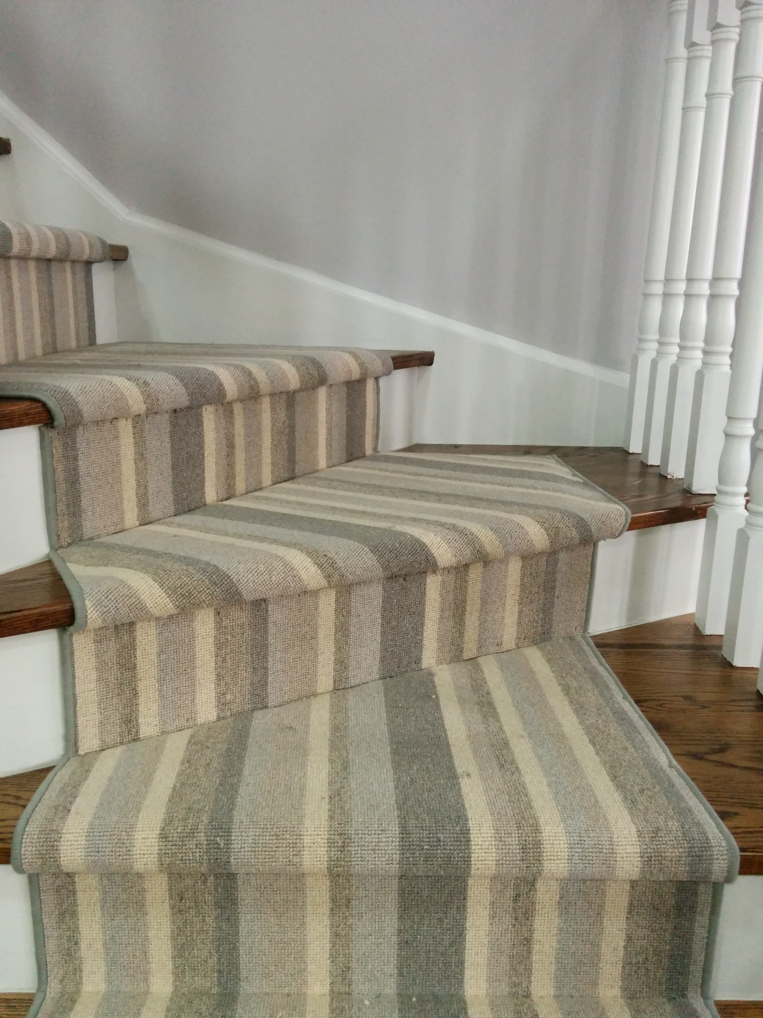 Grey colour striped carpet for stairs runner on pie staircase in Toronto
