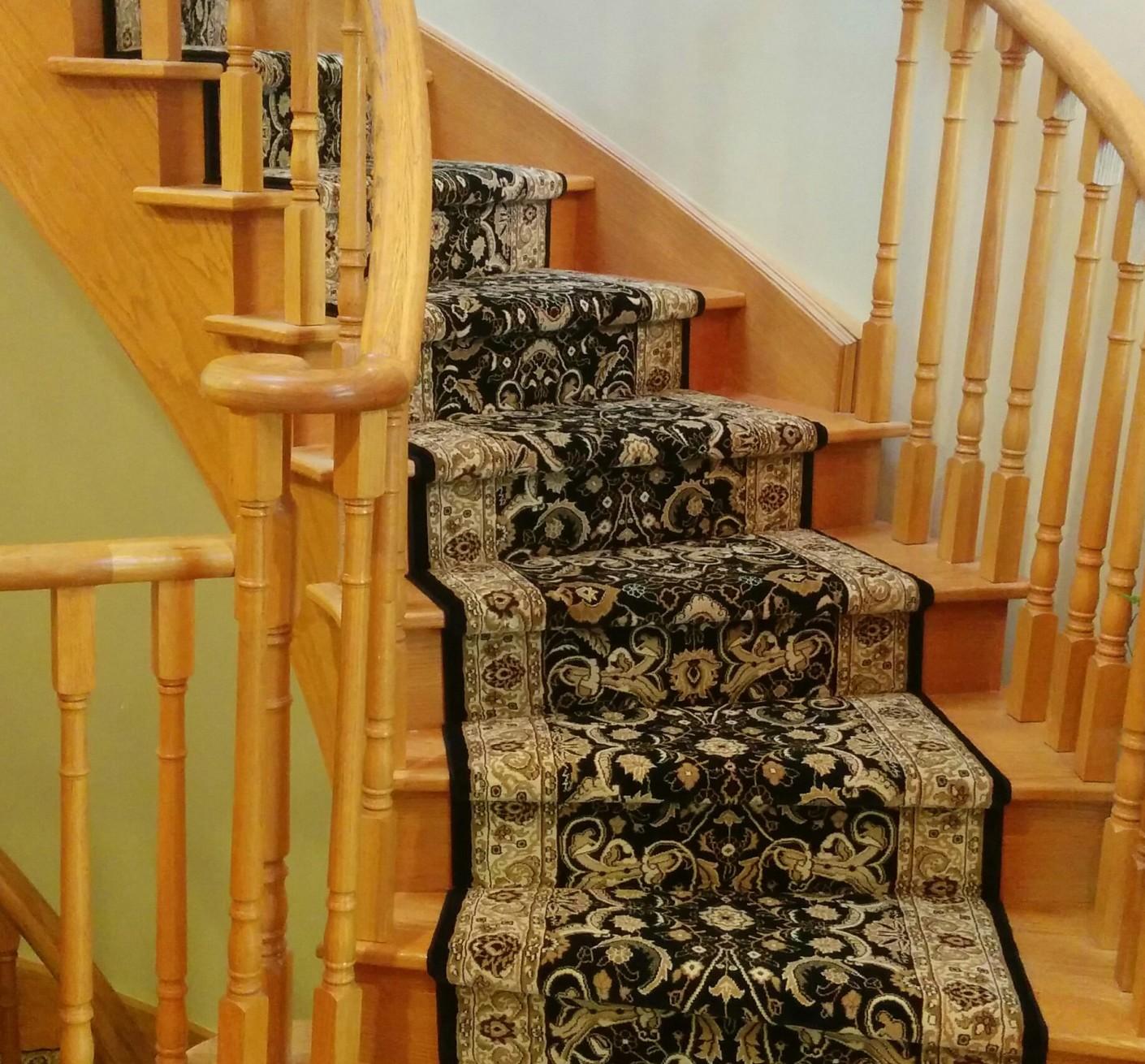 black carpet runner on stairs
