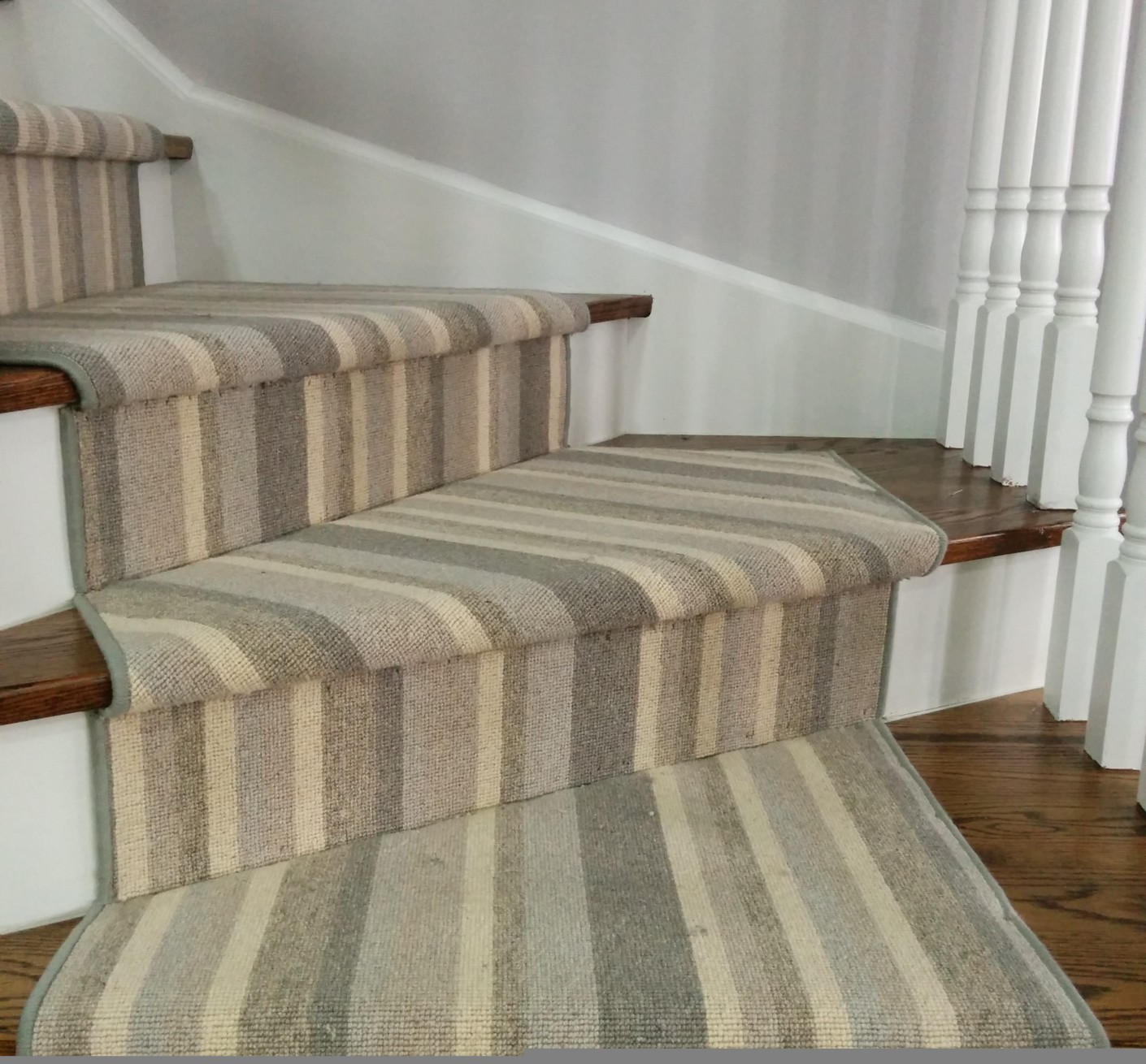 Wool striped carpet runner on staircase sales and installation services in Toronto